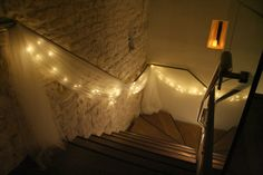 organza and fairy lights on staircase