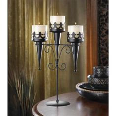 As a fascinating focus piece or a dramatic décor accent, this stately stand creates a lasting impression! Deep black finish accentuates every shapely detail and creates stunning contrast to a triple candle flame. http://www.wholesalemart.com/Wholesale-Candle-Holders-s/85.htm