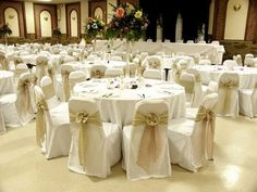 Standard elegant white chair covers with white sashes.