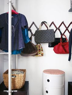 Zigzag hooks are a key organizing tool. They keep everything from bags in the closet to towels in the bathroom neat.