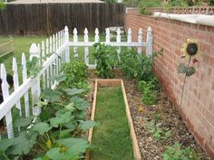 Love the idea of separating the space with a little picket fence