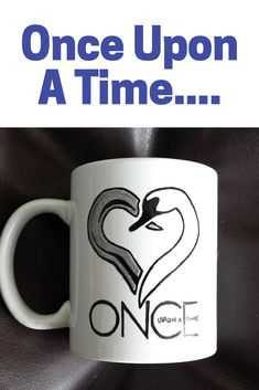 Hand painted mug featuring a heart in the shape of hook and swan. #ouat #emmaswan #captainhook #coffeemug #etsy #ad