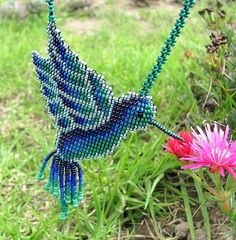 Seed bead hummingbird.  I found this really awesome Etsy listing at https://www.etsy.com/listing/212619055/seed-beaded-hummingbird-spirit-animal