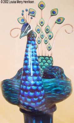 Peacock Fountain: Utilises an integral pump & ducting. The water is recycled within the basin. Made from high fired stoneware clay / http://www.lmhceramics.com/sculptures/all_works.php#