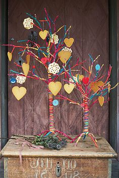 Wire tree covered in colorful rope? fabric strips? Originally sold by Anthropologie but no longer available.