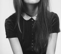 Simple classy peter pan collar that focuses on the colar by the use of black vs. white.