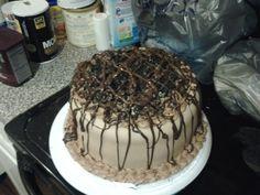 Vanilla cake. Chocolate frosting and marshmallow chocolate fondant. Oreo crumble and chocolate drizzle.   WickedSweetatreats413@gmail.con