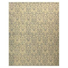 gray and yellow hooked rug