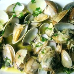Ameijoas à Bulhão-pato (Clams à Bulhão-pato) - After being soaked two to three hours to release the sand, the clams goes into a pan with olive oil and garlic. Season with coriander, lemon juice and white wine. The dish is named after Raimundo António de Bulhão Pato (1828-1912), Portuguese writer, politician and poet who is best known for recipes the created like clams, hare or grouper.