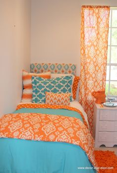 Beautiful dorm room bedding in blue and orange mix of patterns.  Stunning. design your today! Add a monogram,window panels, bed skirt or custom headboard