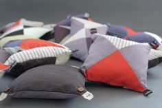 Cushions with buttons and buttonholes on all the corners. So cool, and easy to do.