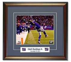 New York Giants Odell Beckham Jr. Makes The Catch of a Lifetime! Framed 8x10 Photo. (Horizontal)  Price : $69.99 http://legends-gallery.hostedbywebstore.com/Giants-Beckham-Lifetime-Framed-Horizontal/dp/B00Q7DZY8M