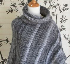 A fantastic crochet women's cowl neck poncho in a cape style. Gorgeous marble colors. Black, grays and whites tweed striped throughout the pattern.  Asymmetrical fit with a draped cowl neck and mid length make this a perfect piece for the changing seasons. A great layering piece!  Grab it to drive in the car, walk around the mall, just about anything you want to do. Perfect accessory to slip on over your denim to your best slacks.  One Size Fits most (Small, Medium, Large)
