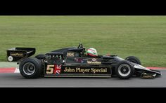 """LOTUS TYPE 78 - not happy with the performance of the 76, Colin Chapman, inspired by the inner wing section of the DeHavilland Mosquito aircraft, set out to design a """"wing car.""""  Using wide and long sidepods with novel radiator cooling intakes and exit ducts, sideskirts that extended to the track surface--the beginning of ground effects in F1."""