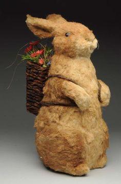 Large Easter sitting rabbit, with basket glass eyes, Circa 1920.