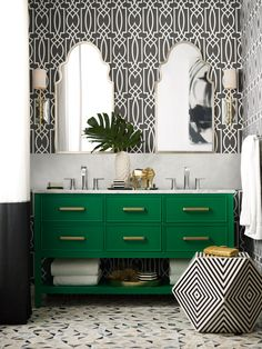 We love this modern green, black and white geometric bathroom with a bold wallpaper and silver and gold fixtures. If you're thinking about updating your bathroom, tap to find all the bathroom design inspiration you could want in this post as we share 13 beautiful bathroom decor ideas to inspire your next bathroom remodel. From powder rooms, soaker tubs, mixed metallic bathroom fixtures, to chandeliers and elegant pendant lighting in the bathroom, we've got it! Hadley Court Interior Design… Beautiful Bathroom Decor, Green Vanity, Bathroom Design Inspiration, Bathroom Interior Design, Bathroom Decor, Classic Bathroom, Powder Room Design, Green Bathroom, Bathroom Remodel Pictures