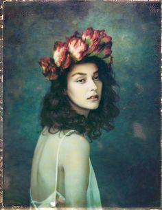 Polaroids — Emily Soto. Emily captures a rather dreamy look with this model. The tones of colour which casts on her model, the positioning portrayed, and the prop of a head dress to offset slight of dress is well thought out, one would suspect..<3
