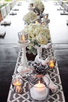 long wood banquet table with painted white votive holders, gray and white runner, silvered succulents and drift wood