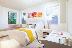 While most of the teenage girls' bedrooms are furnished with pink color, this white bedroom is highlighted with yellow. The white color is prominent in this room aside from the pillows, the bench foam, and the wall frames.