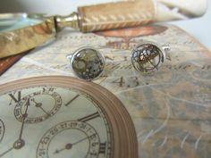 Steampunk cuff links with vintage watch parts,  cogs and Gears  embedded in clear resin in Silver coloured casing. Great present for him by InspiredbySteamPunk on Etsy