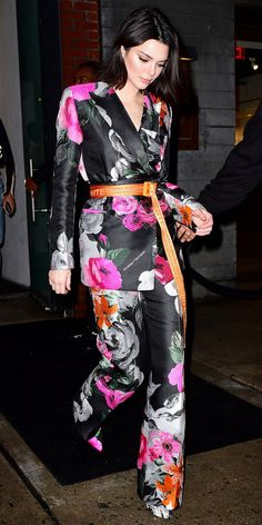 Kendall Jenner made a show-stopping entrance at a Jimmy Choo event, wearing a floral Off-White blazer ($1,860; neimanmarcus.com) and trousers ($1,330; neimanmarcus.com) paired with an orange belt by the same label. Off White Blazer, Off White Belt, Only Fashion, White Fashion, Star Fashion, Fashion Tips, Fashion Outfits, Womens Fashion, Kendall Jenner Style