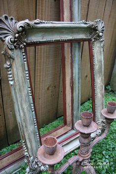 This picture frame from Jennifer of The Back Porch Mercnatile  is simply gorgeous.  Would you believe that the ornate frame is actually plas...