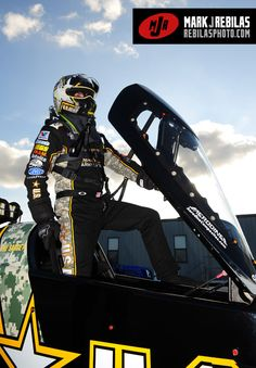 Tony Schumacher climbing into the capsule as he prepared to make a pass in his futuristic fueler.