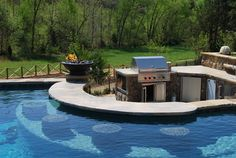 simple outdoor kitchen with swim up bar