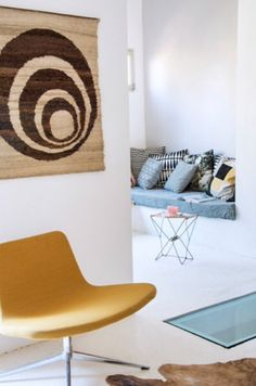"This comfy yellow chair is from our feature ""Casual in Carcassonne"""