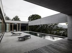 House of Yards is an exceptionally minimalist concrete house designed by Austria-based Marte.Marte Architects and built into a slope, on a site overlo...