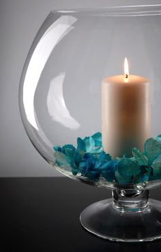candle centerpiece in oversized brandy glass vase