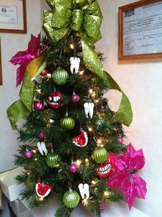"Our ""dental"" Christmas tree! I hand made the dental ornaments! Little Bristles, pediatric dentist in Salinas, CA @ www.littlebristlespediatricdentistry.com"