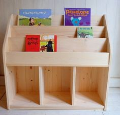 Create this book storage! Crates on the bottom to hold baby dolls