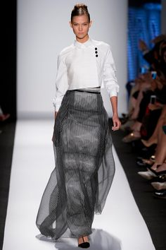 Carolina Herrera Spring 2014  Fashion Week - Runway - Vogue.  I know that the stripes and tulle is a little busy; however with the clean white jacket...it works