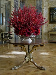 Another BEAUTY!! Masses of ilex and amaryllis in a silver tureen by Carolyn Roehm is exquisite...