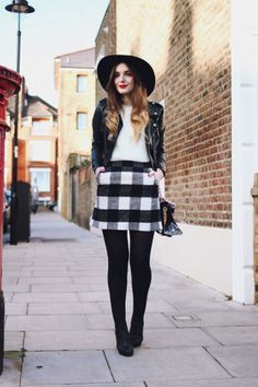 Winter Outfits - how to style tights: oversized black & white plaid mini skirt worn with a leather jacket, wide brimmed hat + black tights and ankle boots