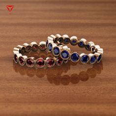 These rings will make you swoon and fall in love.✨ Red Garnet ❤️ or Blue Sapphire 💙? Buy it TODAY & Wear it TOMORROW as these beauties are in #ReadyToShip Collection.🤗 💍: Arria/46473 . . . #yourpersonalejeweler #trijewels_official #jewelryaddict #women #finejewerly #ootd #accessories #bridal #fashion #redgarnet #bluesapphire #roundbrilliant #engagementring #rings #eternityband #jewelry #customjewelry #madeinnyc #westernfashion #couplegoals #stackingrings #newyork Diamond Gemstone, Gemstone Jewelry, Red Garnet, Eternity Bands, Custom Jewelry, Blue Sapphire, Fine Jewelry, Engagement Rings, Bridal Fashion