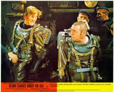 & Land (Kirk Douglas) and Conseil (Peter Lorre) prepare for a diving expedition' Sci Fi Movies, Disney Movies, Nautilus Submarine, Peter Lorre, Leagues Under The Sea, Kirk Douglas, Adventures By Disney, Jules Verne, Underwater World