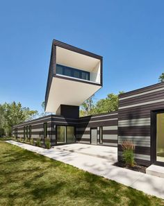 Bower House by Kariouk Associates This house, very close to Lake Erie, Ontario, is mostly a bungalow. But it has this wonderful master bedroom unit perched above the trees, like a nest in a tree. So that part is a treehouse.