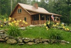traditional log cabin in the spring in Vermont