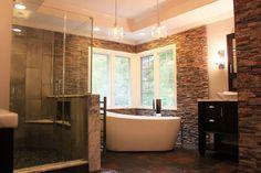 Master bath freestanding tub, spa-like feel with stacked stone and slate floors