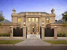 This luxurious gated home is located at 172 Kooyong Road in the exclusive Toorak neighborhood of Melbourne, Victoria, Australia. It was designed by Christopher Doyle with immaculate interiors by Stuart Rattle and impeccable gardens by