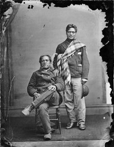 Unidentified Maori men photographed between by WJ Harding of Wanganui. One is seated and the other stands alongside. Both wear jackets, trousers, and boots and one wears a plaid blanket over his shoulder. Leather Men, Leather Jacket, Maori People, Rain Suit, National Symbols, Plaid Blanket, How To Make Shoes, Are You The One, Australia