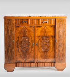 an art deco sideboard book matched walnut veneer with carved detailing and marble top