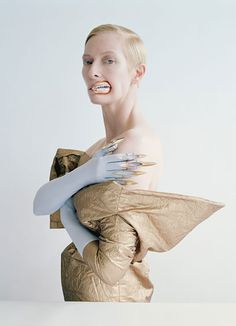 Tilda Swinton photograph for W magazine by Tim Walker and styled by Jacob K in a Vera Wang Collection dress; Vicki Beamon lips and fingertips; Cornelia James gloves. Styled by Jacob K