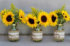 Centerpieces: sunflowers and solid aster in mason jars wrapped with burlap and lace and tied with jute // Celebration Flair