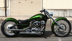 Yamaha V-Star 650 custom with extended tank, solo seat and metallic green paint job