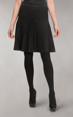 got this skirt.  Pairing it with tights & white blouse for classic look.