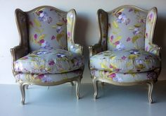 Pair of elegant floral wingchairs with show wood arms and legs