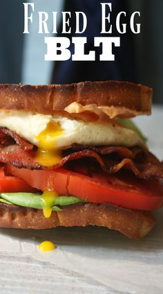 Fried Egg BLT Sandwich recipe. Layers of Bacon, Lettuce and Tomato topped with a…